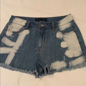 Tinsel denim shorts.  In new condition